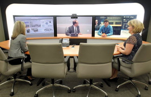 MCPc employees demonstrate Cisco Telepresence System.jpg